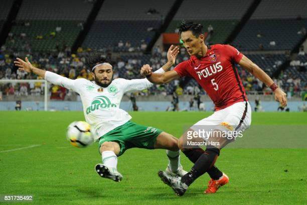 Tomoaki Makino of Urawa Red Diamonds and Apodi of Chapecoense compete for the ball during the Suruga Bank Championship match between Urawa Red...