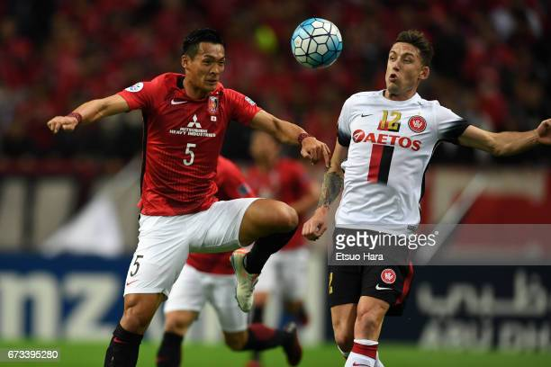 Tomoaki Makino of Urawa Red Diamonds and Scott Neville of Western Sydney compete for the ball during the AFC Champions League Group F match between...