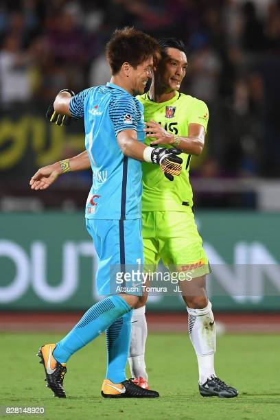 Tomoaki Makino of Urawa Red Diamonds and Shusaku Nishikawa of Urawa Red Diamonds celebrate their 10 win after the JLeague J1 match between Ventforet...