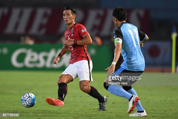 Tomoaki Makino of Urawa Red Diamonds and Yu Kobayashi of Kawasaki Frontale compete for the ball during the AFC Champions League quarter final first...