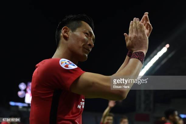Tomoaki Makino of Urawa Red Diamonds applauds after the AFC Champions League Group F match between Urawa Red Diamonds and Western Sydney at Saitama...