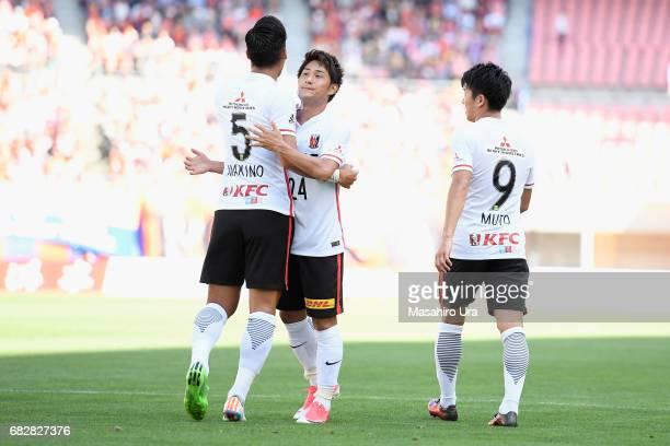Tomoaki Makino of Urawa Red Diamonds celebrates scoring his team's third goal with his team mates Takahiro Sekine and Yuki Muto during the JLeague J1...