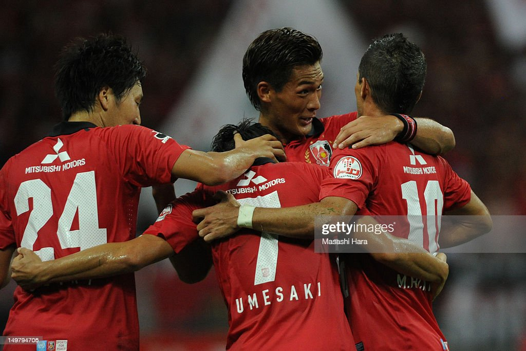 <a gi-track='captionPersonalityLinkClicked' href=/galleries/search?phrase=Tomoaki+Makino&family=editorial&specificpeople=775804 ng-click='$event.stopPropagation()'>Tomoaki Makino</a> #20 of Urawa Red Diamonds (2R) celebrates the second goal by Marcio Richardes #10 (R) with Tsukasa Umesaki #7,Ganki Haraguchi #24 (L) during the J.League match between Urawa Red Diamonds and FC Tokyo at Saitama Stadium on August 4, 2012 in Saitama, Japan.