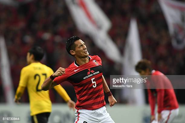 Tomoaki Makino of Urawa Red Diamonds celebrates the win during the AFC Champions League Group H match between Urawa Red Diamonds and Guangzhou...