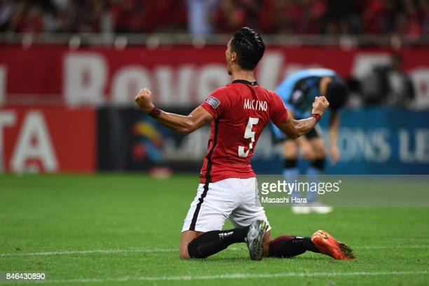 Tomoaki Makino of Urawa Red Diamonds celebrates the win during the AFC Champions League quarter final second leg match between Urawa Red Diamonds and...