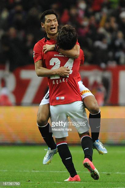Tomoaki Makino of Urawa Red Diamonds celebrates the win with Genki Haraguchi during the JLeague match between Urawa Red Diamonds and Nagoya Grampus...