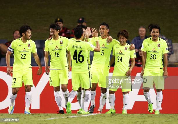 Tomoaki Makino of Urawa Red Diamonds celebrates with team mates after scoring a goal during the AFC Asian Champions League match between the Western...