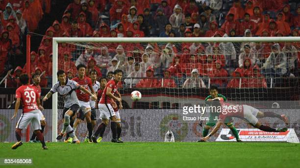 Tomoaki Makino of Urawa Red Diamonds dives for the ball during the JLeague J1 match between Urawa Red Diamonds and FC Tokyo at Saitama Stadium on...