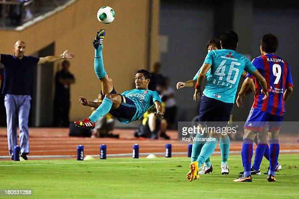 Tomoaki Makino of Urawa Red Diamonds in action during the JLeague match between FC Tokyo and Urawa Red Diamonds at the National Stadium on September...