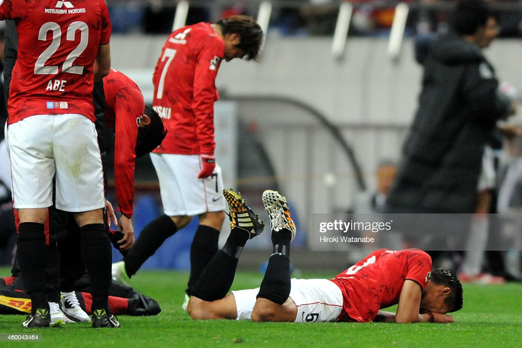 <a gi-track='captionPersonalityLinkClicked' href=/galleries/search?phrase=Tomoaki+Makino&family=editorial&specificpeople=775804 ng-click='$event.stopPropagation()'>Tomoaki Makino</a> of Urawa Red Diamonds reacts after the 1-2 defeat in the J.League match between Urawa Red Diamonds and Nagoya Grampus at Saitama Stadium on December 6, 2014 in Saitama, Japan.