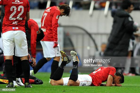 Tomoaki Makino of Urawa Red Diamonds reacts after the 12 defeat in the JLeague match between Urawa Red Diamonds and Nagoya Grampus at Saitama Stadium...