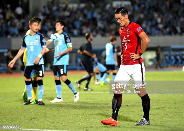 Tomoaki Makino of Urawa Red Diamonds shows dejection after his side's 13 defeat in the AFC Champions League quarter final first leg match between...