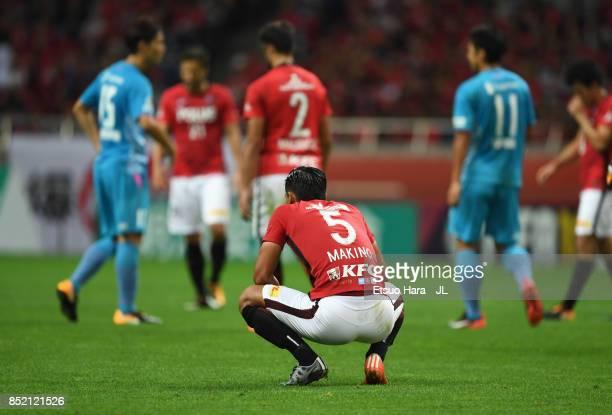 Tomoaki Makino of Urawa Red Diamonds shows dejection after the 22 draw in the JLeague J1 match between Urawa Red Diamonds and Sagan Tosu at Saitama...