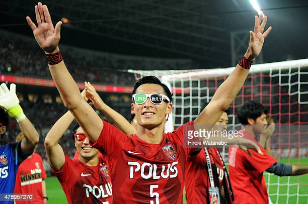 Tomoaki Makino of Urawa Reds celebrates his team's 52 win and undefeated first stage champion after the JLeague match between Urawa Red Diamonds and...
