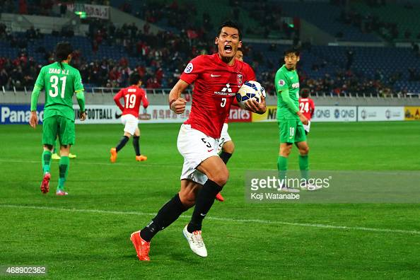 Tomoaki Makino of Urawa Reds celebrates scoring his team's goal during the AFC Champions League Group G match between Urawa Red Diamonds and Beijing...