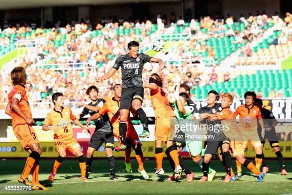 Tomoaki Makino of Urawa Reds scores his team's third goal during the JLeague match between Shimizu SPulse and Urawa Red Diamonds at Ecopa Stadium on...