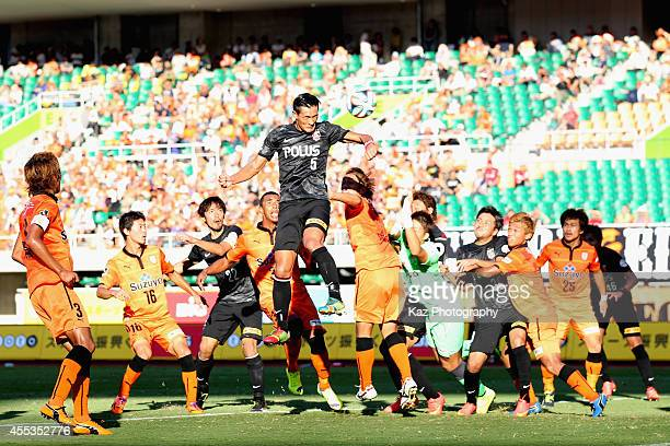 Tomoaki Makino of Urawa Reds scores his team's third goal during the JLeague match between Shimizu SPulse and Urawa Red Diamonds at Ecopa Stadium on...