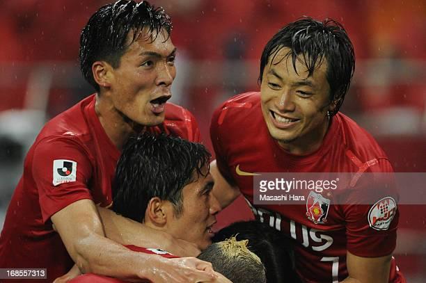 Tomoaki Makino Tsukasa Umesaki and teammates celebrate their team's second goal during the JLeague match between Urawa Red Diamonds and Kashima...