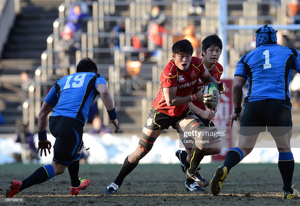Tomoaki Nakai of Brave Lupus runs with the ball during the Top League Playoff semi final match between Panasonic Wild Knights and Toshiba Brave Lupus at Prince Chichibu Stadium on January 20, 2013 in Tokyo, Japan.