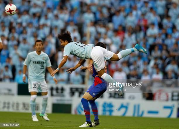 Tomohiko Miyazaki of Jubilo Iwata and Shoya Nakajima of FC Tokyo compete for the ball during the JLeague J1 match between Jubilo Iwata and FC Tokyo...