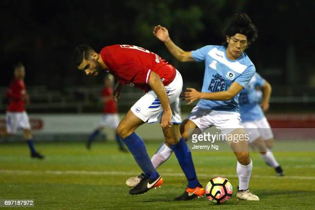 Tomohiro Kajiyama of the Sharks and Yanni Fragogiannis of United 58 contest for the ball during the NSW NPL Men's match between Sutherland Sharks FC...