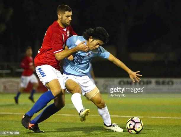 Tomohiro Kajiyama of the Sharks is tackled by Yanni Fragogiannis of United 58 during the NSW NPL Men's match between Sutherland Sharks FC and Sydney...
