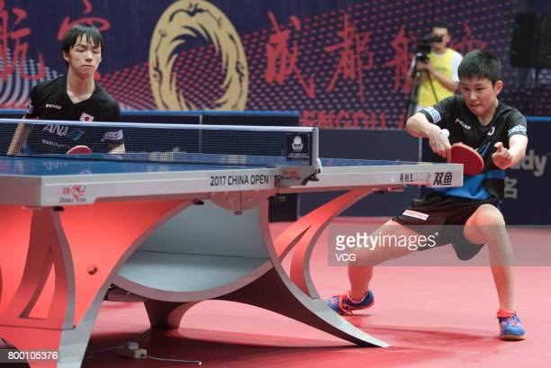 Tomokazu Harimoto and Yuto Kizukuri of Japan compete during the men's doubles semifinal match against Fan Zhendong and Xu Xin of China on the day two...
