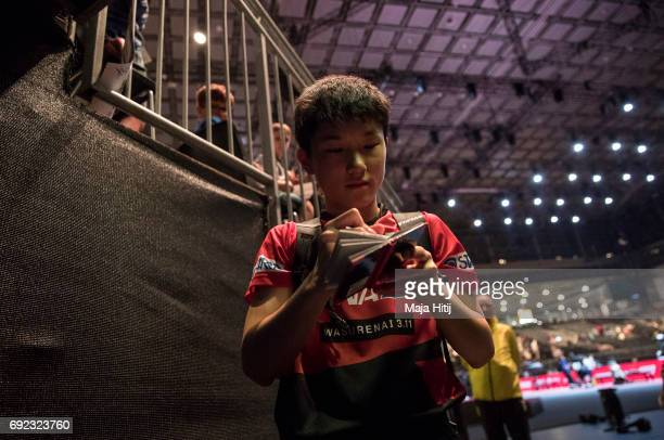 Tomokazu Harimoto of Japan gives autographs during Men's Singles quarter Final at Table Tennis World Championship at at Messe Duesseldorf on June 4...