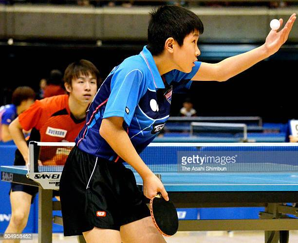 Tomokazu Harimoto serves against Koki Niwa in their Men's Singles Fourth round match during day four of the All Japan Table Tennis Championships at...