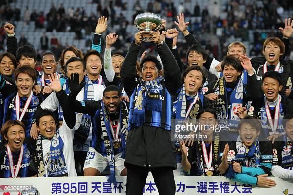 Tomokazu Myojin of Gamba Osaka holds the cup after the 95th Emperor's Cup final between Urawa Red Diamonds and Gamba Osaka at Ajinomoto Stadium on...