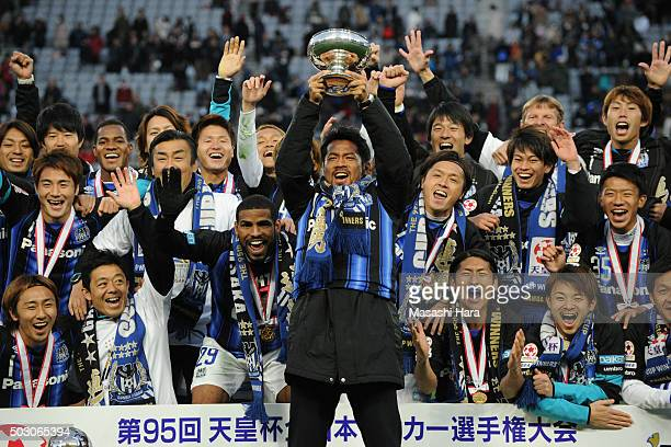 Tomokazu Myojin of Gamba Osaka holds the cup after the 95th Emperor's Cup final between Urawa Red Diamonds and Gamba Osaka at Ajinomoto Stadium on...