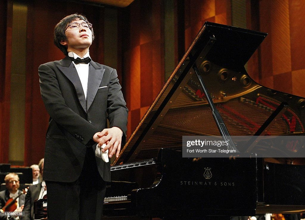 Tomoki Sakata, of Japan, takes a bow after performing a concerto with the Fort Worth Symphony Orchestra during the 14th Van Cliburn International Piano Competition in Fort Worth, Texas, Sunday June 9, 2013.