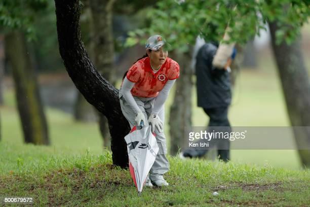 Tomoko Yokoyama of Japan prepares for a second shot on the 18th hole during the final round of the Yupiteru The Shizuoka Shimbun SBS Ladies at the...