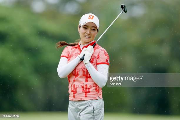 Tomoko Yokoyama of Japan reacts after a putt on the 18th green during the final round of the Yupiteru The Shizuoka Shimbun SBS Ladies at the Shizuoka...
