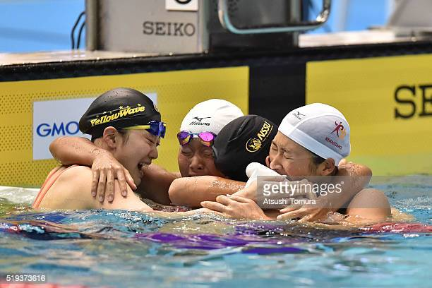 Tomomi Aoki of Japan Sachi Mochida of Japan Chihiro Igarashi of Japan and Rikako Ikee of Japan celebrate after the Women's 200m Freestyle final...