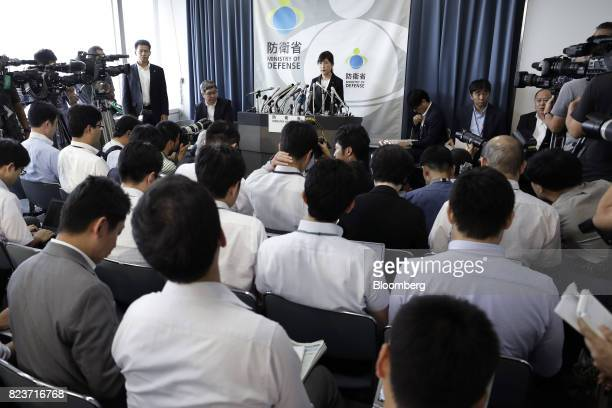 Tomomi Inada Japan's defense minister top center speaks during a news conference at the Ministry of Defense in Tokyo Japan on Friday July 28 2017...
