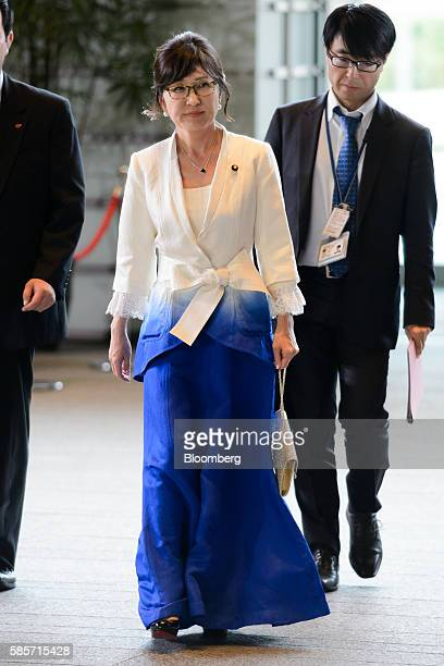 Tomomi Inada the newly appointed defense minister of Japan arrives at the official residence of Japan's Prime Minister Shinzo Abe not pictured in...