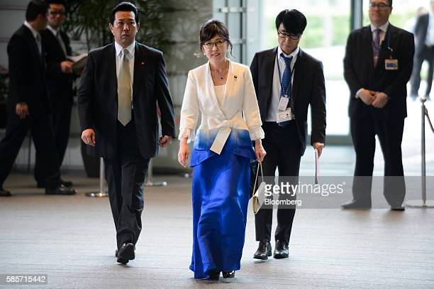 Tomomi Inada the newly appointed defense minister of Japan center arrives at the official residence of Japan's Prime Minister Shinzo Abe not pictured...