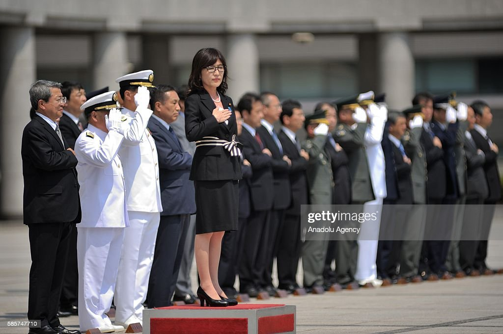 http://media.gettyimages.com/photos/tomomi-inada-the-newly-appointed-defense-minister-of-japan-reviews-a-picture-id585747710?k=6&m=585747710&s=594x594&w=0&h=XZt3S-lTPKA757v1D1L_z9uFUNIxr7UVo96iZQIWBuM=