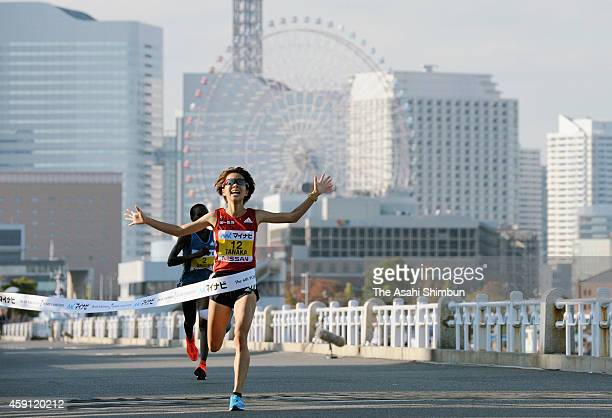 Tomomi Tanaka of Japan crosses the finishing tape to win in the 6th Yokohama International Women's Marathon on November 16 2014 in Yokohama Kanagawa...