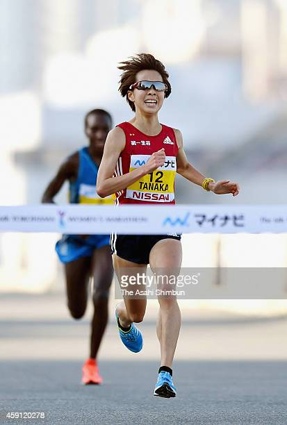 Tomomi Tanaka of Japan leads Philes Ongori of Kenya to win in the 6th Yokohama International Women's Marathon on November 16 2014 in Yokohama...