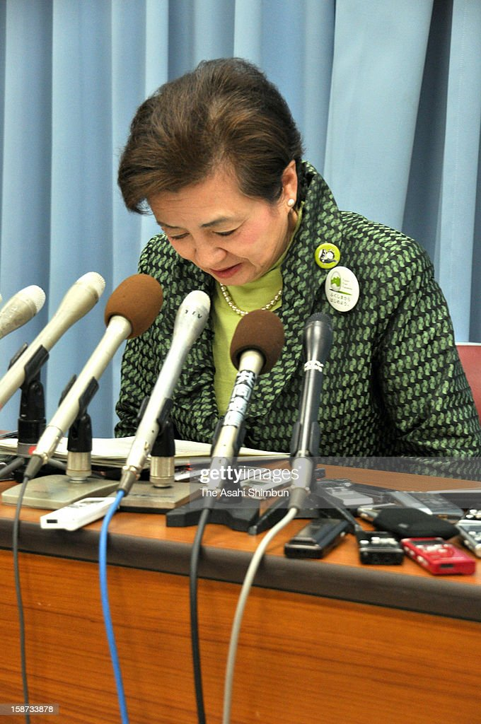 Tomorrow Party of Japan president Yukiko Kada bows during a press conference at Shiga Prefecture headquarters on December 26, 2012 in Otsu, Shiga, Japan. The party will be divided to two parties only one month after the foundation.