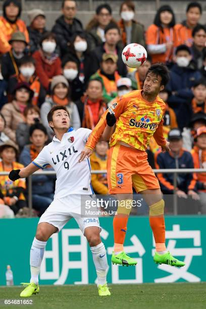 Tomoya Inukai of Shimizu SPulse and Yuma Suzuki of Kashima Antlers compete for the ball during the JLeague J1 match between Shimizu SPulse and...