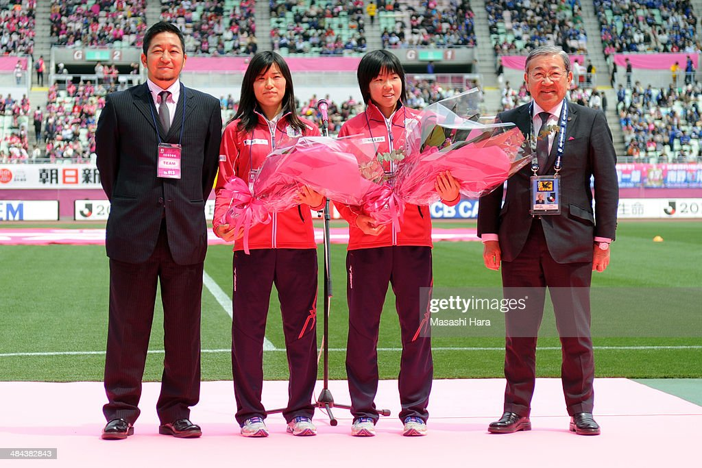 Tomoya Takehana, coach of Cerezo Osaka Sakai Ladies, Meika Nishida and <a gi-track='captionPersonalityLinkClicked' href=/galleries/search?phrase=Shiho+Matsubara&family=editorial&specificpeople=12550876 ng-click='$event.stopPropagation()'>Shiho Matsubara</a>, members of FIFA U-17 Women's World Cup, and Masao Okano, president of Cerezo Osaka look on before the J.League match between Cerezo Osaka and Gamba Osaka at Nagai Stadium on April 12, 2014 in Osaka, Japan.