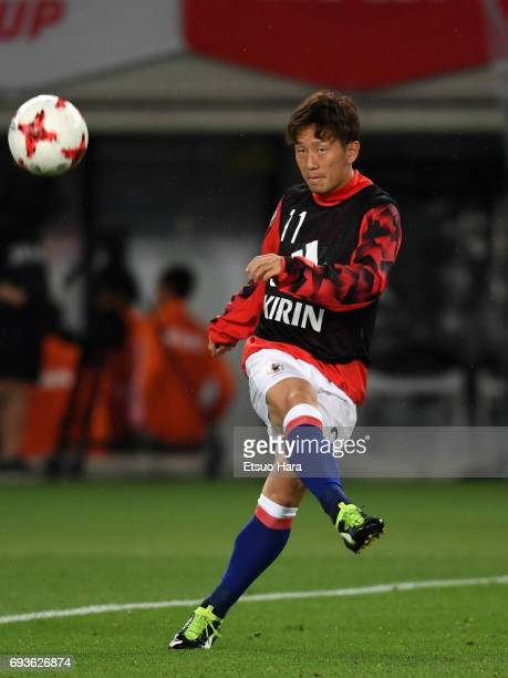 Tomoya Ugajin of Japan warms up during the international friendly match between Japan and Syria at Tokyo Stadium on June 7 2017 in Chofu Tokyo Japan