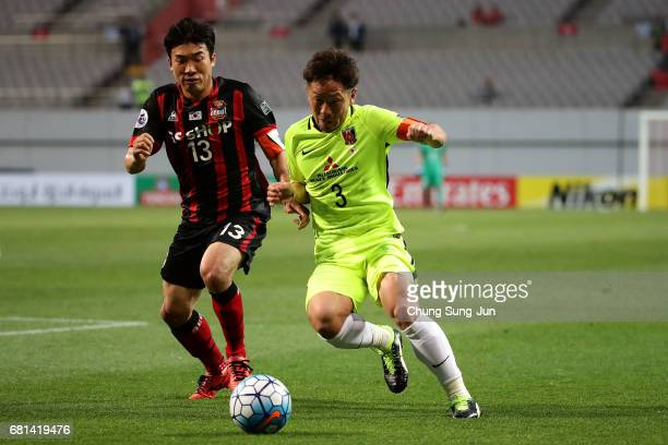 Tomoya Ugajin of Urawa Red competes for the nall with Hwang HyunSoo and Go YoHan of FC Seoul during the AFC Asian Champions League Group F match...