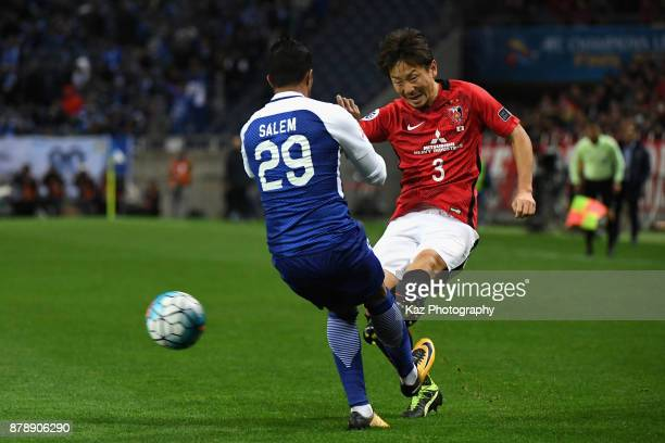 Tomoya Ugajin of Urawa Red Diamonds and Salem Al Dawsari of AlHilal compete for the ball during the AFC Champions League Final second leg match...