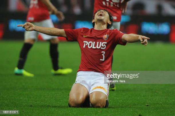Tomoya Ugajin of Urawa Red Diamonds celebrates during the JLeague match between Urawa Red Diamonds and Omiya Ardija at Saitama Stadium on October 5...
