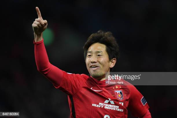 Tomoya Ugajin of Urawa Red Diamonds celebrates scoring his team's fourth goal during the AFC Champions League match Group F match between Urawa Red...