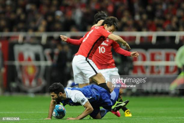 Tomoya Ugajin of Urawa Red Diamonds fouls on Omar Khribin of AlHilal resulting in an yellow card during the AFC Champions League Final second leg...